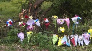 Flowers have been laid at the crash scene