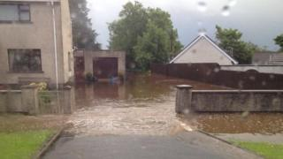The flooded driveway of a house near Randalstown