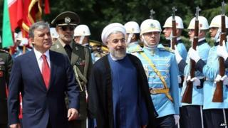 Abdullah Gul (left) and Hassan Rouhani (centre) in Ankara (9 June 2014)