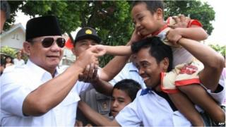 Prabowo Subianto greets his supporters during the July 2014 Presidential election campaign in Malang, East Java, on June 6