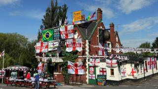 Decorations and flags outside The Robin Hood public house, in Jarrow, England