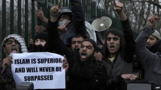 "Protesters holding a banner that says ""Islam is superior and will never be surpassed"""