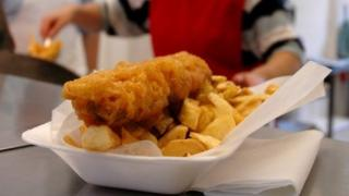 Fish and chips in polystyrene container
