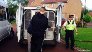 A suspect is taken away by police in Hartlepool