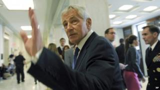 Defence Secretary Chuck Hagel arrives on Capitol Hill in Washington, 11 June 2014