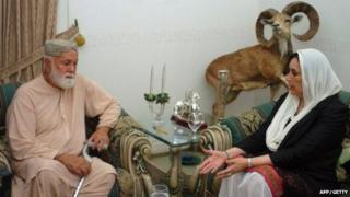Pakistani former premier Benazir Bhutto (R) talks with Nawab Khair Bakhsh Marri, father of Balach Marri, who was killed by security forces, at his residence in Karachi, 22 November 2007.