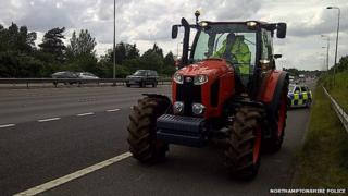 tractor pulled over on M1