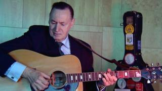 Campbell Gunn with guitar