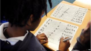 A pupil working out maths