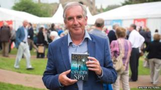 Robert Harris with his book in Melrose
