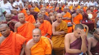 Sri Lanka imposes curfew after Buddhist-Muslim clashes