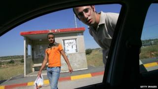File image of Israeli hitchhikers in the Samaria region of the West Bank