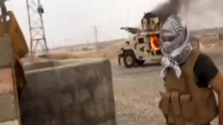 Iraqi Revolution, a group supporting the al-Qaida breakaway Islamic State of Iraq and the Levant (ISIL) on Wednesday, June 11, 2014, shows a militant in Tikrit, Iraq
