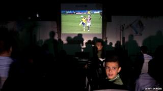 File image: Viewers watch Brazil v Croatia in Gaza City