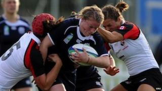 Keri Holdsworth (centre) in action for Scotland Women