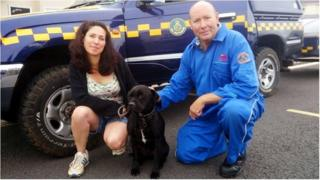 John Bunce, a member of the Torbay Coastguard rescue team, Harry, a Staffordshire bull terrier cross breed dog, and his owner Amanda Wileman