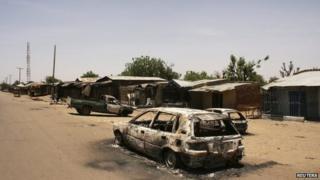 A burnt car is seen along a road in Buni Gari village in Nigeria's northeastern state of Yobe, 6 April 2014