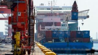 Shipping barge with containers in Japan