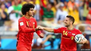 Marouanne Fellaini and Dries Mertens celebrate as Belgium beat Algeria 2-1 at the 2014 Fifa World Cup in Brazil .