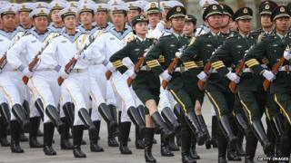 Members of an honour guard march during a welcome ceremony for Portuguese President Anibal Cavaco Silva held by Chinese President Xi Jinping outside the Great Hall of the People on 15 May 2014 in Beijing.