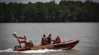 Malaysian search and rescue personnel on a speed boat search for passengers of a sunken boat in outskirt of Banting, Malaysia, on Wednesday, 18 June, 2014