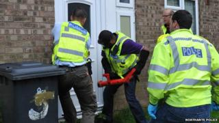 Police raiding a house in Wellingborough