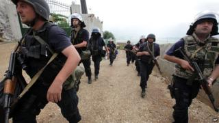 Albanian police enter the lawless village of Lazarat on 18 June 2014