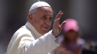 Pope Francis greets the crowd after his general audience at St Peter's square on 18 June, 2014 at the Vatican
