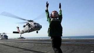 Sea Hawk helicopter lands on aircraft carrier USS George HW Bush in Gulf. 17 June 2014