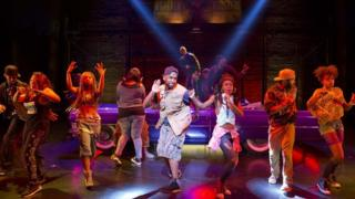 The cast of Holler If Ya Here Me performing California Love at the Palace Theater in New York