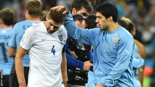 Suarez offers a few comforting words for his Liverpool captain Gerrard