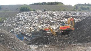 The mounds of rubbish on Terrence Davies' land