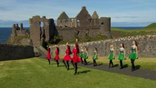 Ceilidh dancers at Dunluce Castle in Northern Ireland