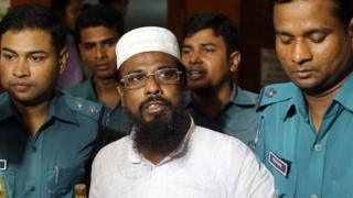 Bangladeshi policeman produce Mufti Abdul Hannan, leader of banned radical group Harkat-ul Jihad al-Islami, at a court in Dhaka, Bangladesh on Monday, 16 June, 2014