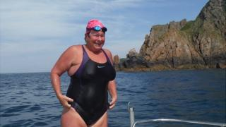 Sally Minty-Gravett after swimming from Sark to Jersey