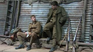 Soldiers in the trenches in the play Mametz