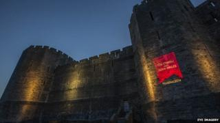 The red logo was projected on to castles around Wales