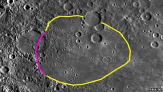 Coloured lines outline the shape of Aneirin Crater