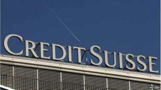 The logo of Swiss bank Credit Suisse is seen on an office building in Zurich May 20, 2014