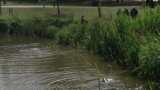 Police diving and searching for weapons in Barnet