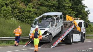 Crashed minibus being removed