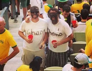 "A photo of two fans with their faces blacked-up and t-shirts saying ""Ghana"" posted to Instgram by Jason Spears"