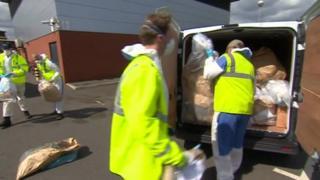 Drugs being loaded into transit van