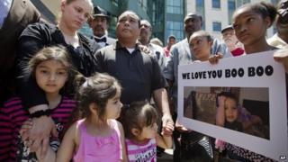 Parents of 19-month-old Bounkham Phonesavanh attend vigil