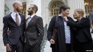 Plaintiffs Derek Kitchen (left), Moudi Sbeity (second from left), Kate Call (second from right) and Karen Archer (right) appeared outside the courthouse after a federal appeals court heard oral arguments on a Utah state law forbidding same sex marriage in Denver on 10 April 2014
