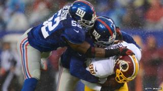 Players from the New York Giants and the Washington Redskins appeared in Rutherford, New Jersey, on 29 December 2013