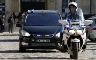 A car thought to be taking Nemmouche from court leaves Versailles