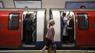 Commuters on a crowded Northern Line tube train