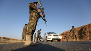 Afghan national army soldiers search a car at a checkpoint on the outskirts of Jalalabad, east of Kabul