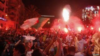 Algerian fans celebrate in Algiers - 26 June 2014